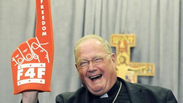 "Cardinal Timothy Dolan of New York brandishes a foam finger promoting the ""Fortnight for Freedom"" campaign last week."