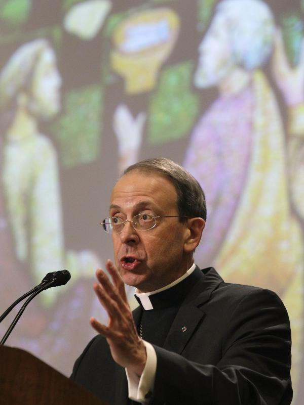 Archbishop William Lori, pictured speaking on religious freedom at the U.S. Conference of Catholic Bishops' annual fall assembly, says Catholics are behind the Fortnight for Freedom campaign. He dismissed a poll that found 57 percent of Catholics are not worried about their religious liberties.