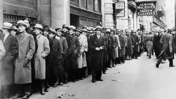 Thousands of unemployed people wait outside the State Labor Bureau in New York City to register for federal relief jobs in 1933.
