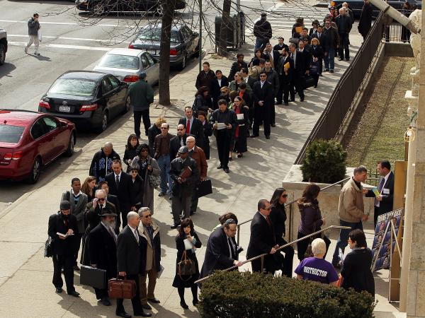 Job seekers wait to attend a job fair in the Brooklyn borough of New York City in 2010.