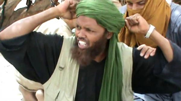 In this image from a video, an Islamist militant celebrates after the destruction of a Sufi shrine earlier this month in Timbuktu.