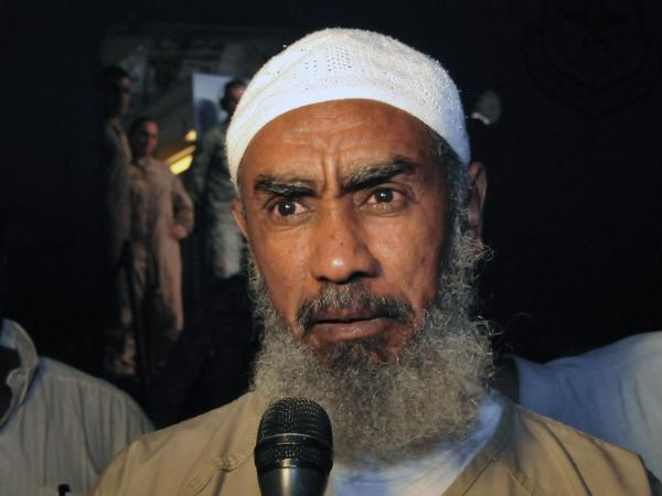 Ibrahim al-Qosi, shown here on July 11 in Khartoum, Sudan, was released from Guantanamo Bay prison this week after spending a decade there. He was Osama bin Laden's former driver, and he pleaded guilty to charges of conspiracy with al-Qaida and supporting terrorism. There are now 168 prisoners remaining at Guantanamo.