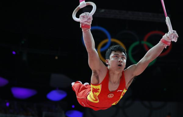 Feng Zhe of China competes on the rings during the men's artistic gymnastics finals.