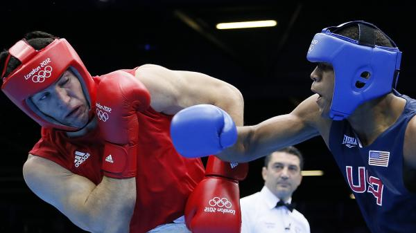 Boxer Michael Hunter Jr. of the U.S. lost a close bout to Artur Beterbiev (left) of Russia in the heavyweight division's Round of 16 at the ExCel Arena Wednesday.