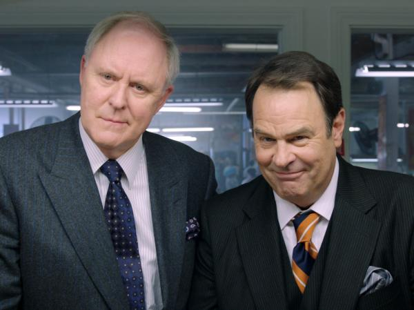 The Motch brothers (John Lithgow and Dan Aykroyd) support Huggins' campaign in hopes of securing their own business interests. The brothers' last name is a not-so-veiled reference to the real-life Koch brothers.