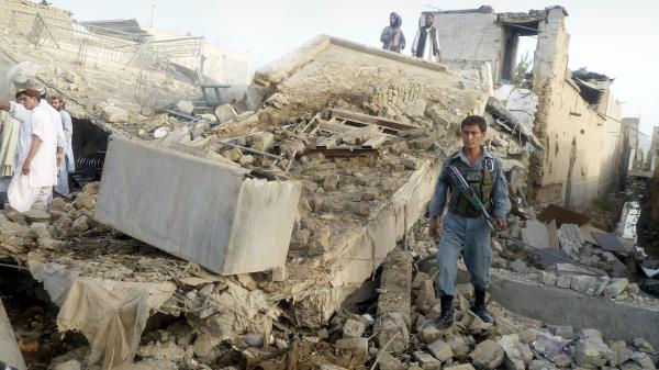 The aftermath of a truck bomb in Kandahar, the main city in southern Afghanistan, which wounded the provincial police chief and killed two civilians Monday. Taliban attacks against Afghan officials are up sharply this year.