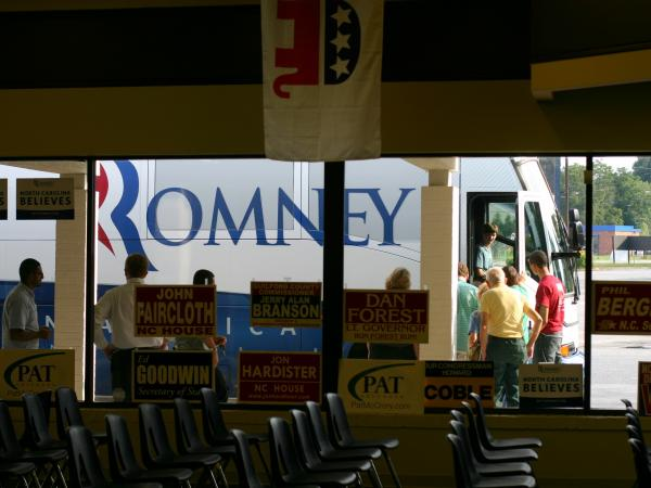 Romney supporters line up to tour the campaign bus.