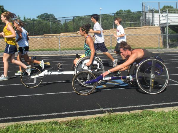 Tatyana McFadden (front), and her sister Hannah practice for the Paralympics on a high school track in Columbia, Md.
