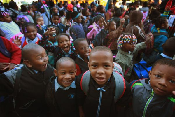 Students at Frazier International Magnet School wait outside before the start of school on Wednesday in Chicago.