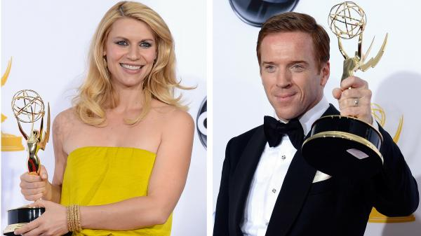 Claire Danes and Damian Lewis hold up their Emmy Awards for Showtime's <em>Homeland</em>.