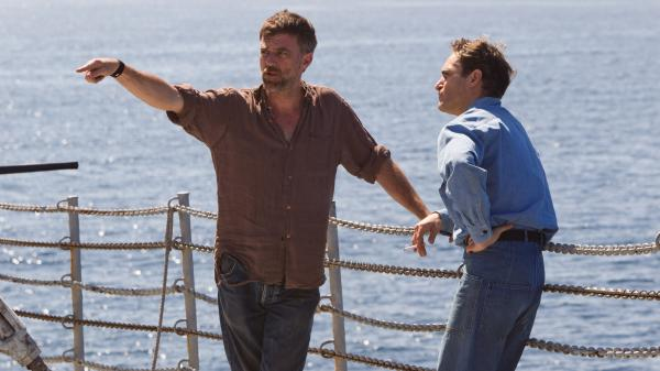 Paul Thomas Anderson (left) works with actor Joaquin Phoenix on the set of <em>The Master.</em>