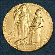 "The medal for the Nobel in Physics. According to the Nobel committee, the inscription reads: "" '<em>Inventas vitam juvat excoluisse per artes' </em>loosely translated 'And they who bettered life on earth by their newly found mastery.' """