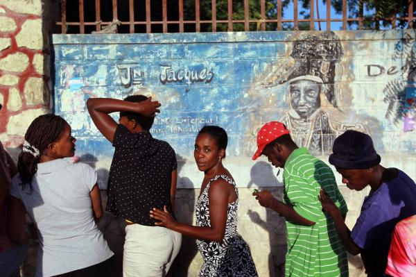 People wait to vote in Haiti's national election in Port-au-Prince, 2010.