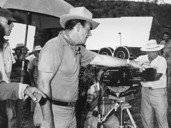 6-foot-4 actor John Wayne directs a scene for the Hollywood movie <em>The Alamo</em> in 1959. Wayne also portrays the reportedly 6-foot-tall Davy Crockett in the movie.