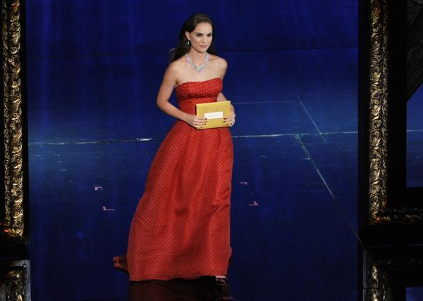 Presenter Natalie Portman, 5 feet 3 inches, at the 84th Annual Academy Awards.