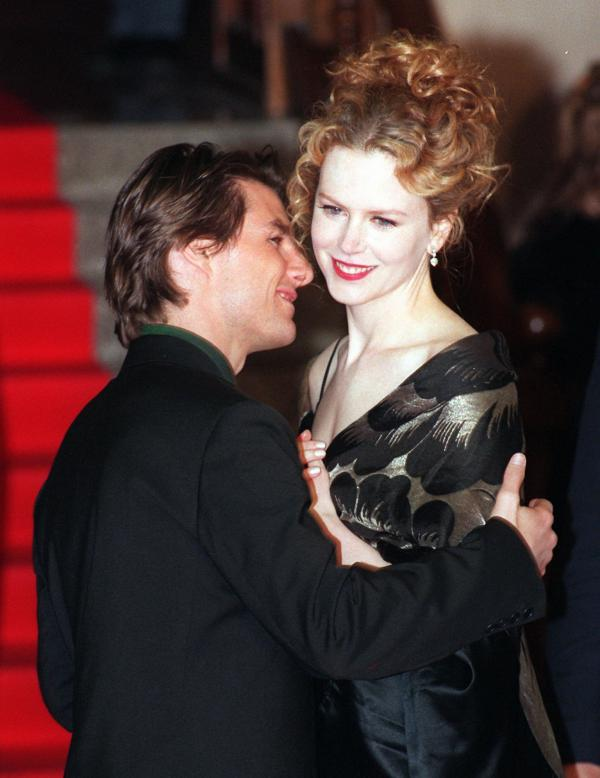 Cruise and his then- wife Nicole Kidman pose for photographers as they arrive at the Italian premiere of his movie <em>Jerry Maguire</em> in 1997.