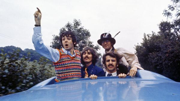 The Beatles look out of the Magical Mystery Tour coach skylight, on location in England in September 1967.