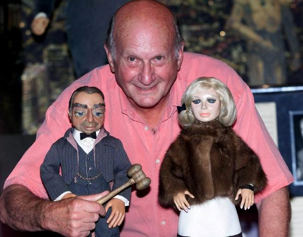 <em>Thunderbirds</em> creator Gerry Anderson has died at age 83. Here, he poses with puppets Parker and Lady Penelope from the series, shortly before a 2001 auction in London.