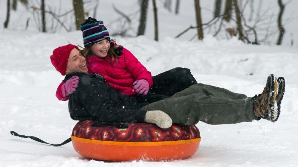 Eric Waite and his 8-year-old daughter Emerson went sliding Thursday in Greenfield, Mass.