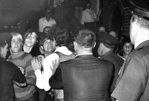 The crowd faces off with police at the Stonewall Inn nightclub raid in the summer of 1969 in New York City.