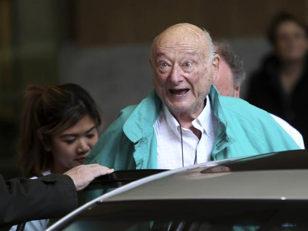 New York City Mayor Ed Koch says goodbye to reporters as he gets in his car after being released from a New York hospital on Dec. 12, 2012.