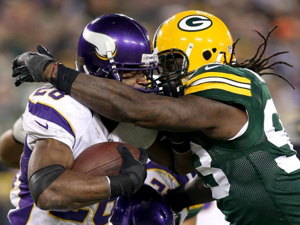 Green Bay Packers Erik Walden hits Minnesota Vikings Adrian Peterson during the NFC Wild Card Playoff game this year.