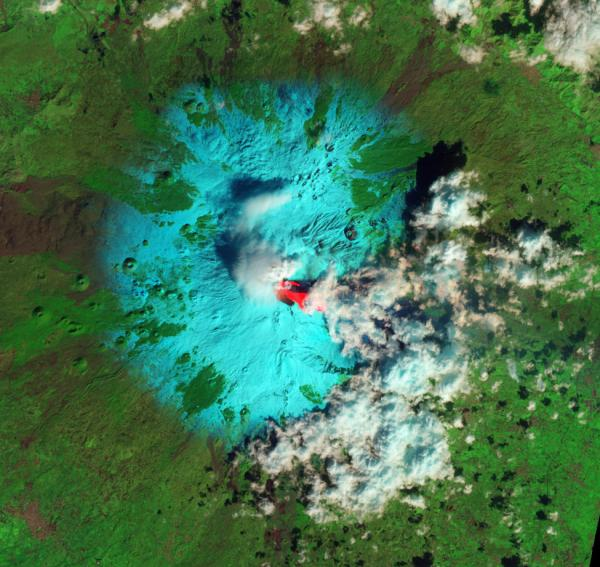 "Sicily's Mount Etna early this week, as seen from space. The bright red is lava. Snow is blue-green. Clouds are white. ""Shortwave infrared, near infrared, and green light"" combine to produce the colors."
