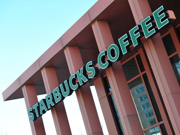 Starbucks is among the companies urging the Supreme Court to strike down the federal government's ban on recognizing same-sex marriages.