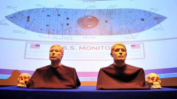 The facial reconstructions of two sailors whose remains were discovered inside the gun turret of the USS Monitor after it was raised from the ocean floor in 2002 are revealed during a 2012 ceremony.