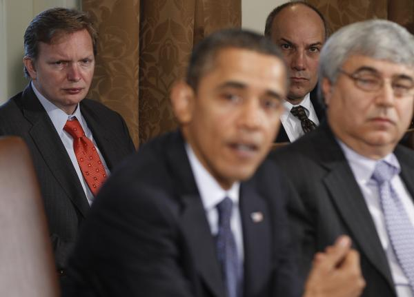 Jim Messina (left), the head of Organizing for Action and a former top Obama campaign and White House aide, watches President Obama make a statement in the White House Cabinet Room in 2010.