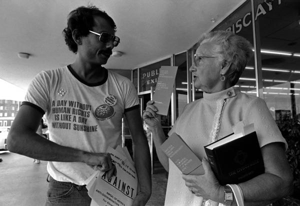 Doris Dennis, a volunteer handing out literature for the Save Our Children group headed by Anita Bryant, gets into a debate with Alan Rockway, a volunteer handing out literature for a gay rights group, at a shopping center in Miami in 1977.