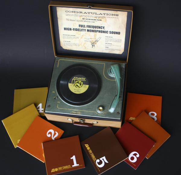 <strong>Ray Charles, <em>Pure Genius - The Complete Atlantic Recordings (1952 - 1959)</em></strong><br />A box containing eight CDs, but made to look like an old record player, complete with a molded-plastic turntable under the lid.
