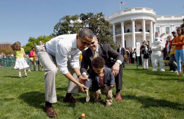 President Obama helps a young participant roll an egg during the 2012 White House Easter Egg Roll on the South Lawn. This year's event will take place on Monday.