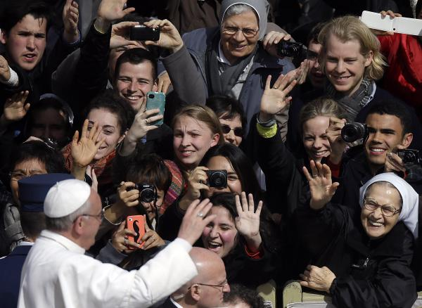 After the Mass in St. Peter's Square, Francis shared in the crowd's exuberance.