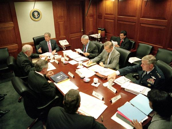 President George W. Bush leads his National Security Council in the Situation Room of the White House on Oct. 12, 2001. At the George W. Bush Presidential Library and Museum, this Situation Room has been rebuilt with the original furnishings.