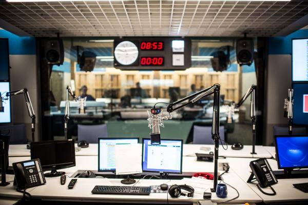 NPR's new studio: The POV from the host's chair. The red one-line telephone used by Steve Inskeep and Renee Montagne, Scott Simon's reading stand from Chicago, RPG diffusor panels, some of the clocks, and coffee mug are familiar surroundings transferred from the old headquarters.