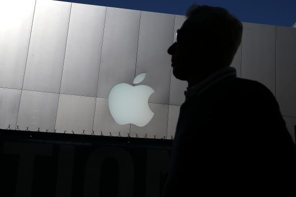 A person walks by an Apple Store on April 23, 2013 in San Francisco, California.
