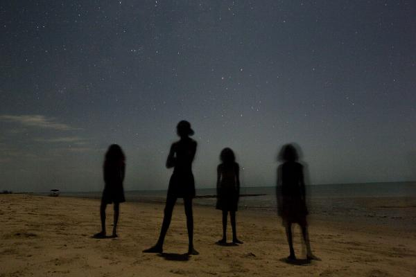 Aboriginal children pause for a portrait in the moonlight out on their ancestral homelands near Cape Stewart in the Northern Territory, Australia.