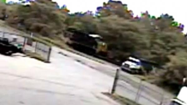 A still image from a video posted by Eastern Truck and Trailer captures a moment just before a commercial truck's trailer was struck by a freight train Tuesday.