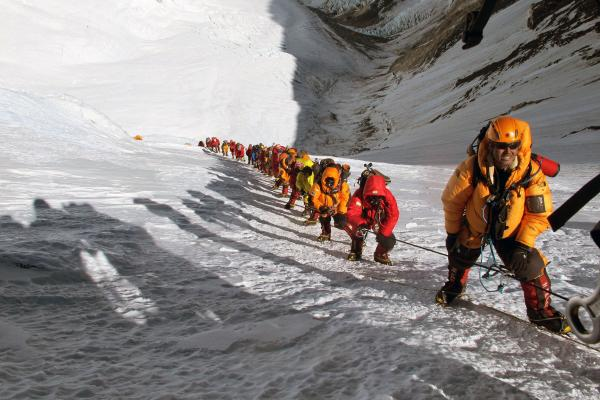 During the 2012 climbing season, long lines encumbered the ascent of the Lhotse face of Mount Everest. This photo from <em>The Call Of Everest </em>was taken after the photographer decided to abort his climb, due to the dangerous lines.