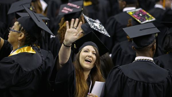 Graduates of Bowie State University wave to friends and family at the school's graduation ceremony in College Park, Md., on May 17. This year's graduates are finding better job prospects than at any time since 2008.