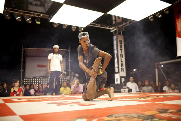 Wellington Costa, 19, performs at the semifinals of a <em>passinho</em> competition in Rio de Janeiro on April 23. <em>Passinho</em> is a liberated dance form born in Rio's <em>favelas</em>, or shantytowns.