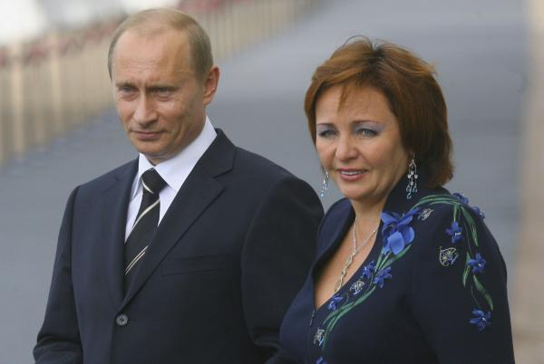 In this handout photo, Russian President Vladimir Putin and his wife, Lyudmila Putina, await the arrival of G-8 leaders for an informal dinner in July 2006 in Peterhof, Russia.
