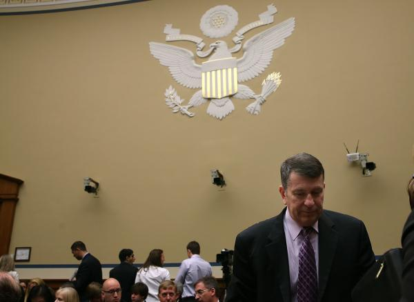 Faris Fink, commissioner of the IRS Small Business and Self-Employed Division, walks away after testifing before the House Oversight and Government Reform Committee, on Capitol Hill, on Thursday.