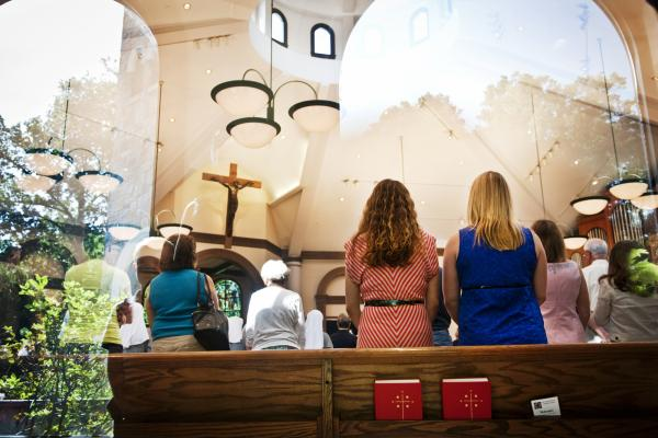 Fabiola Morales and Kelly Costello attend Catholic Mass every Sunday at their local church in Potomac, Md. The women say their faith has kept them strong through the uncertainty.