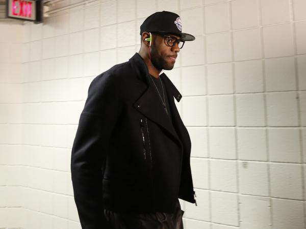 Miami Heat's LeBron James walks the virtual catwalk between the bus and the locker room before a game against the Milwaukee Bucks.