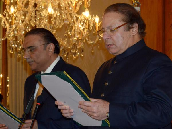 Newly elected Pakistani Prime Minister Nawaz Sharif (right)  during a swearing in ceremony at the Presidential Palace in Islamabad on Wednesday. Sharif has vowed to end U.S. drone strikes in the country.
