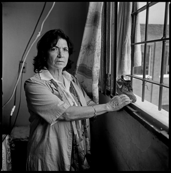 Anahit Aharonian, looking from the window of her former cell in the Punta de Rieles prison in Montevideo, Uruguay. She is a descendant of survivors of the Armenian genocide and was born in Uruguay. She spent 12 years in jail. Montevideo, Uruguay, February 2012.