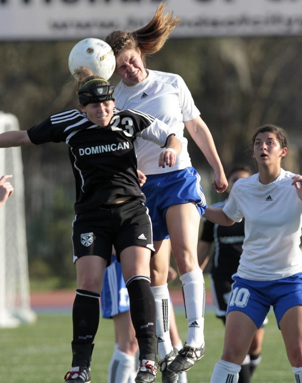 Katherine Cuntz and Sarah Gaudet go up to head the ball during a Louisiana high school championship game in 2011.