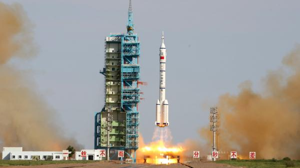 China's Shenzhou-10 rocket blasts off from its launchpad in the Gobi Desert, as China started its longest manned space mission Tuesday.